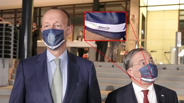 Bei einer Veranstaltung der Jungen Union trugen die drei Kandidaten für den CDU-Parteivorsitz (hier: Friedrich Merz (links) und Armin Laschet) Masken mit DocMorris-Logo. Unter den Apothekern sorgte das für Empörung. (p / Foto: picture alliance/dpa/dpa-pool   Michael Kappeler)
